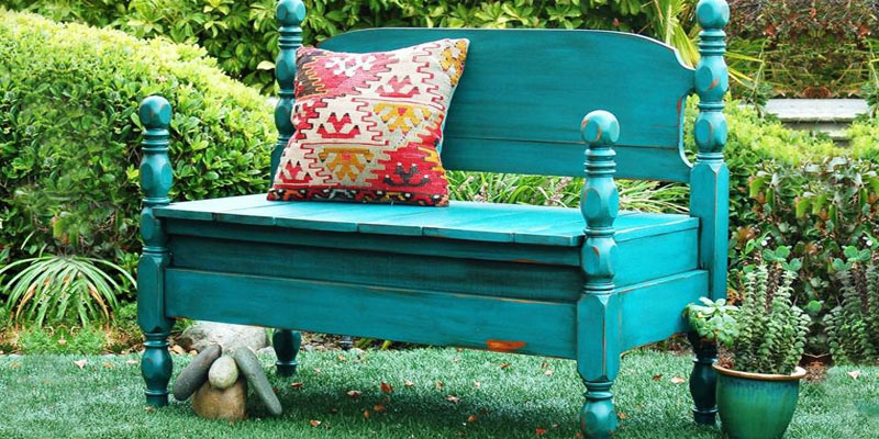 Upcycled garden bench made from an old bed